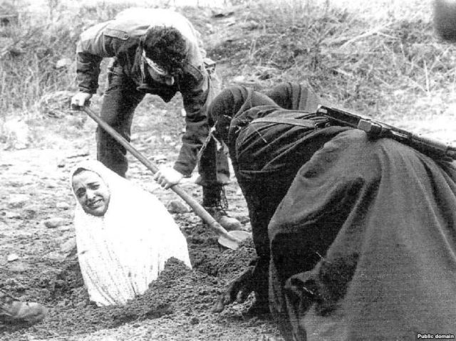 A heretic being prepared for stoning.