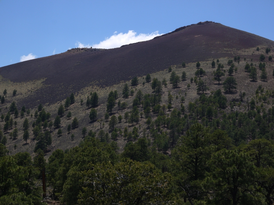 Sunset Crater, in Sunset Crater National Monument. It formed from a violent eruption in 1065 AD, then smoldered and poured out ash for the next hundred years.