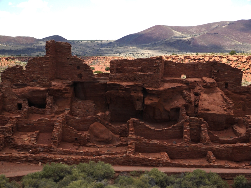 Wupatki Pueblo, Wupatki National Monument, AZ. This hundred room complex is the equivalent to our modern-day shopping mall. Traders traveled for hundreds of miles, to meet and swap good here. And of course, teenagers, bums, and proselytizers may also have used this as a hangout.
