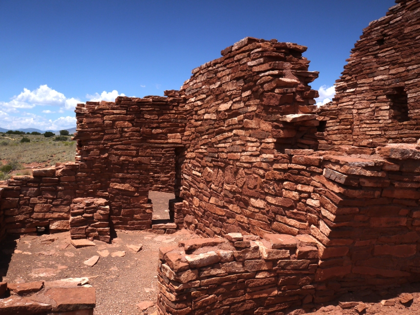 Lomaki Pueblo, Wupatki National Monument. The walls were made of fieldstone, cemented together by some sort of mortar. The few windows were very small. The roofs were constructed of large timbers overlayed by smaller branches, that was then coated by mud. After the pueblos were abandoned, the timbers were scavenged for firewood.